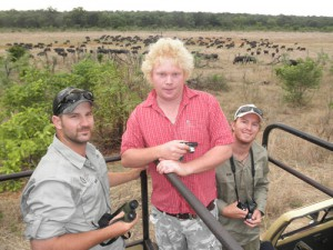 The boys checking out a large herd of buffalo